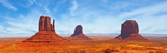 Nature in Monument Valley Navajo Park, Utah USA Red desret landscape, famous view on a beautiful summer day with blue sky and clouds