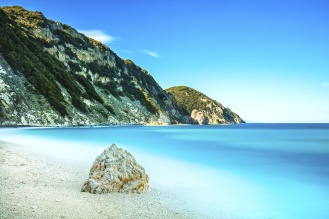 Rock in a blue sea. Sansone beach. Elba island. Tuscany, Italy. Long exposure photography